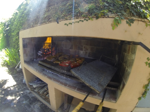 A typical BBQ in Argentina: In the left corner you prepare the coal and the grill grate you can set stepless